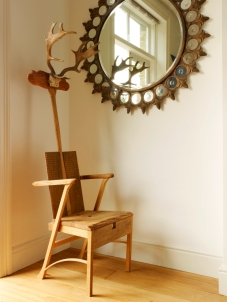 bespoke oak throne with antler goading stick